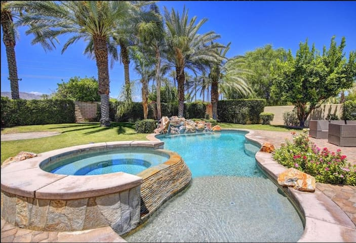 Cascading spa and pool area with swim/tanning shelf and built in umbrellas for shade if needed