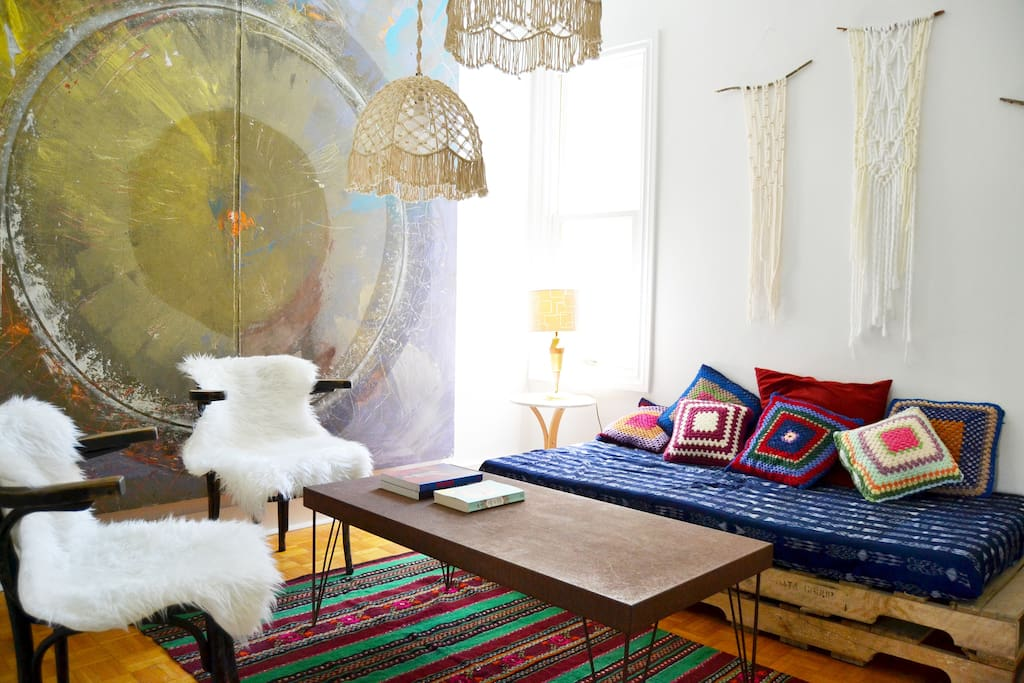 Filled with original art and eclectic mix of bohemian treasures, our living room is a comfy place to hangout during the day and at night the cushion filled sofa turns in to a third bed.