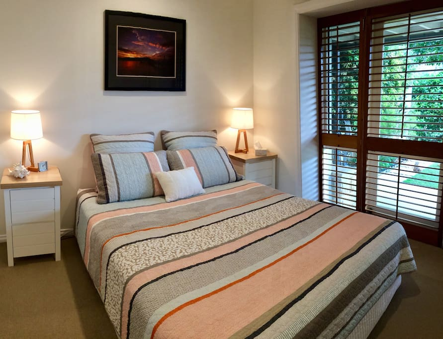 Bedroom with Queen bed, bedside tables, lamps and and ample wardrobe