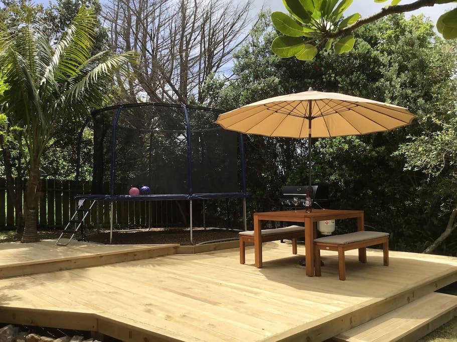 Large deck to soak up the sun or entertain. BBQ & table.