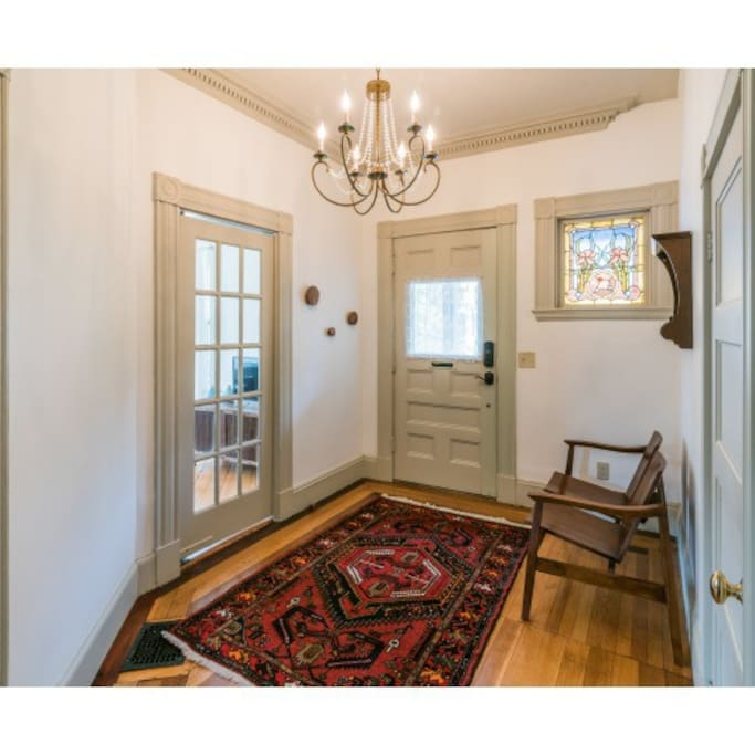 Beautiful, original stained glass window in welcoming foyer