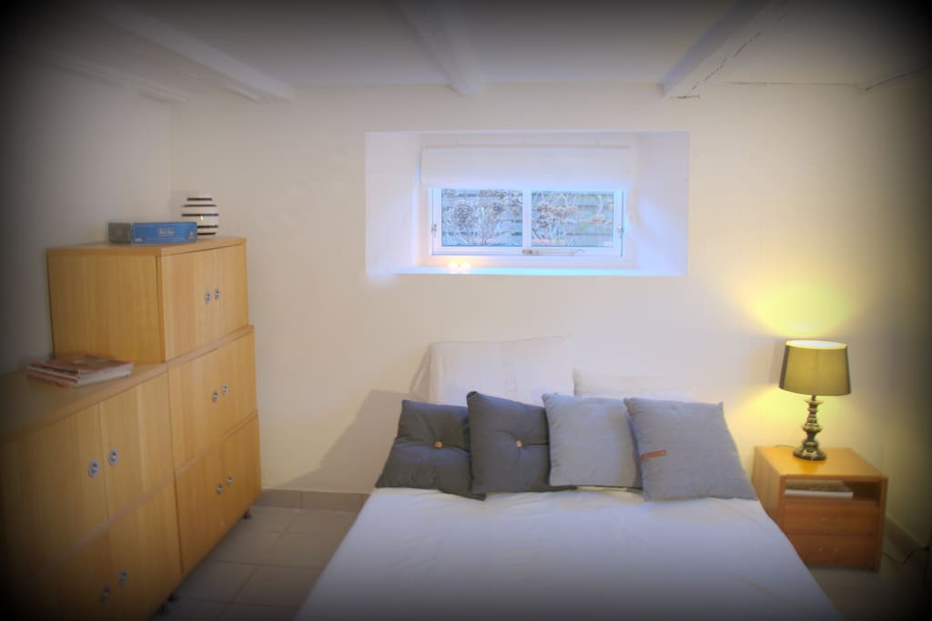 BEDROOM 3: located in high and bright basement + private entry & bathroom & kichenette + classical Danish design + premium quality bed + deluxe Danish duvets + office space with wireless printer & various books + private, direct access to the garden