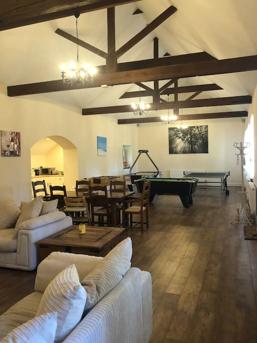 Main living area with pool table, air hockey, table football, ping pong.
