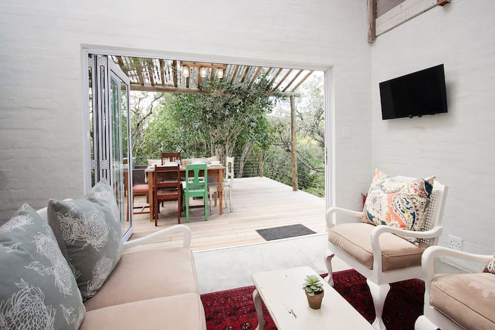 Relax in the lounge and take in the forest views