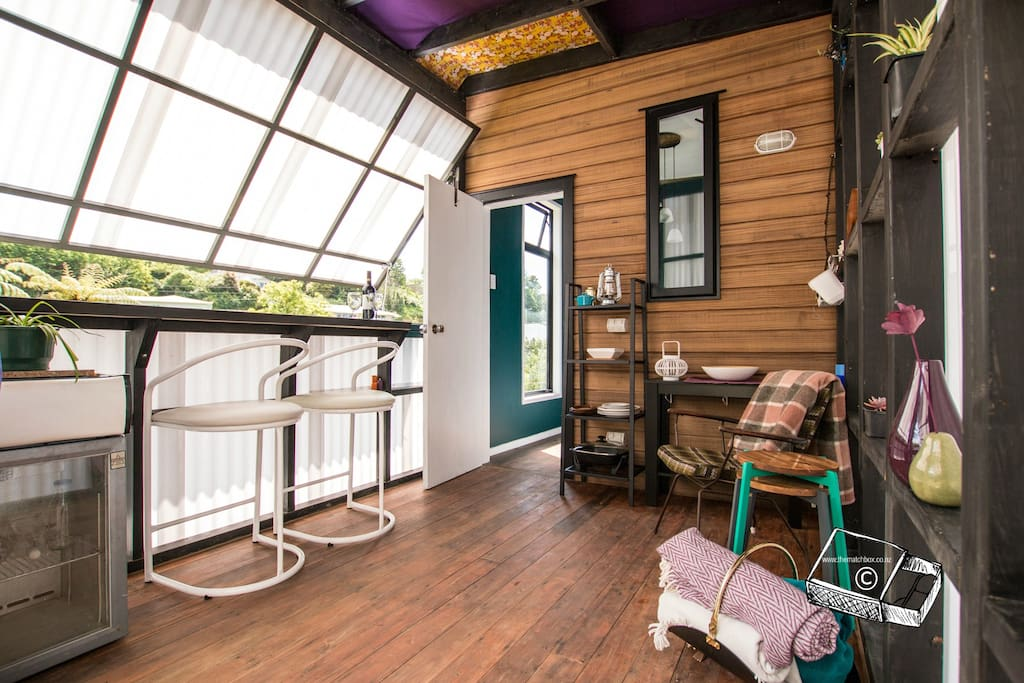 A unique space - fully enclosed porch with two tilt-a-doors that give light or privacy.