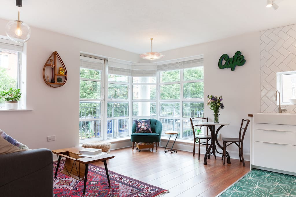 Open-plan living room and kitchen overlooking Patrick's Cathedral