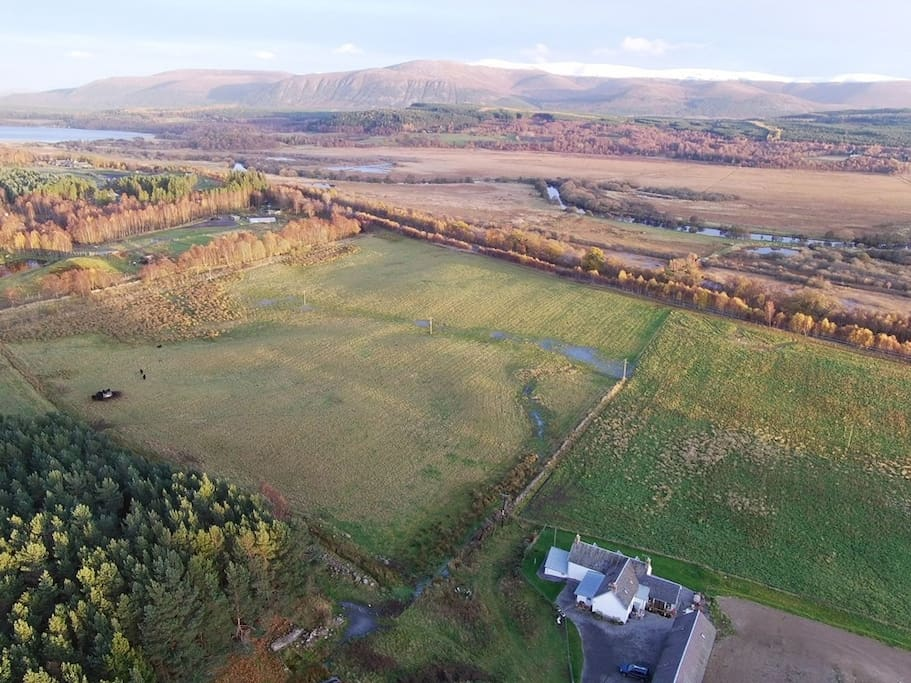 The aerial view above the Farmhouse overlooking Strathspey and the Cairngorms