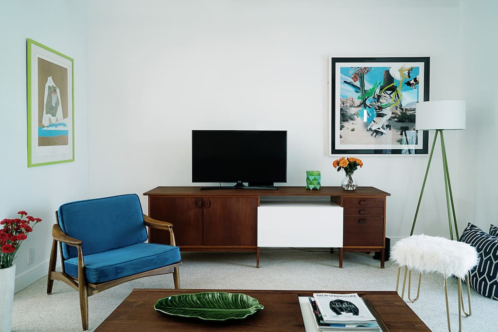Living room furnished with great refurbished vintage Danish mid-century furnitures and Artworks from renowned pop and abstract artists.