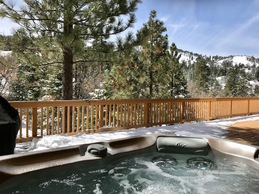 Take in the view of Bear Mountain's slopes while soaking in the hot tub