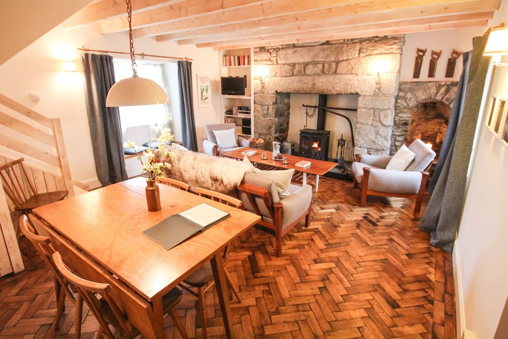Scandi style living room with oak parquet, wood burner and white washed timber