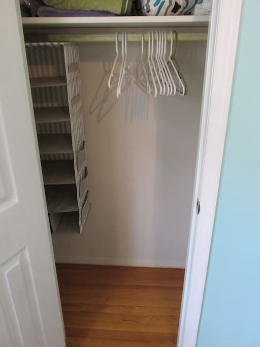 This is the closest which includes hangers and a hanging organizer.