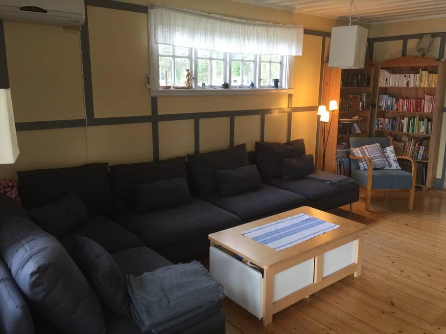 Living room with big, comfortable sofa, fireplace and flatscreen TV