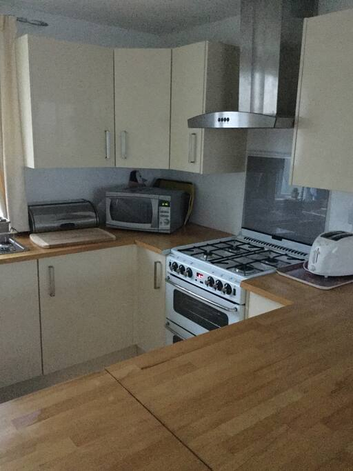 Kitchen- Gas cooker, microwave, Fridge, toaster, Full utensils
