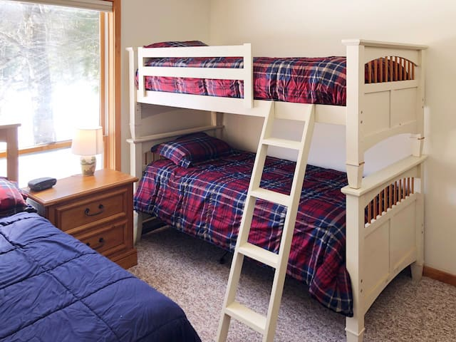 2nd bedroom with bunks and full size bed.  View is the Pemi and Loon.