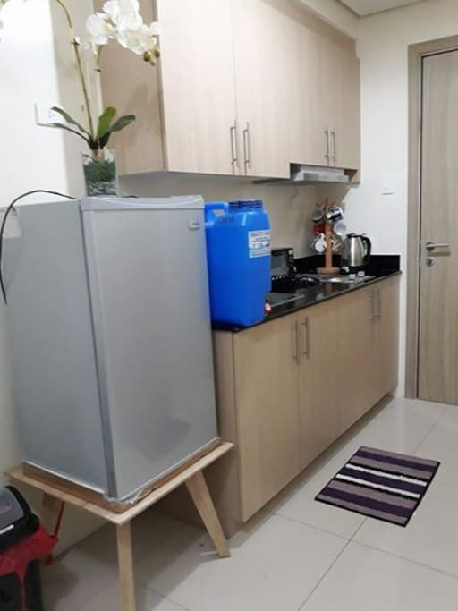 kitchen with refrigerator, oven toaster, rice cooker, and other kitchen utensils