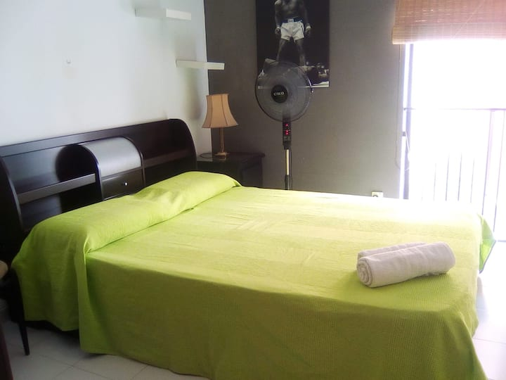 Bedroom with double bed and wardrobe