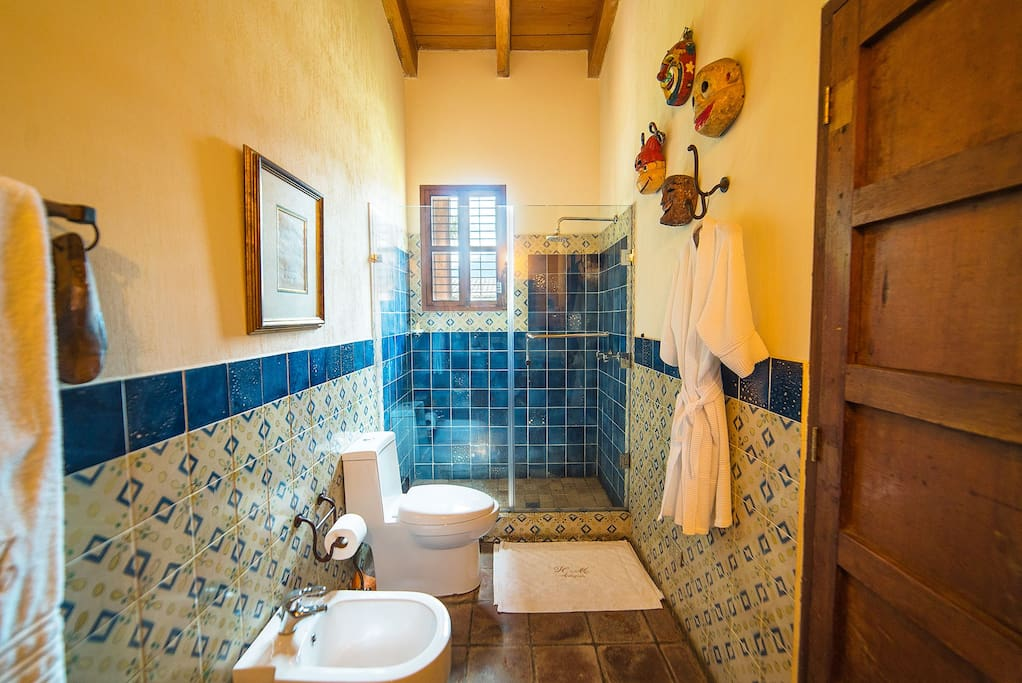 Your private bathroom blends the charm of the traditonal handpainted tiles & antique masks with the modern comfort of tempered glass shower.