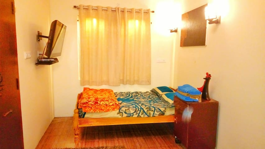 There are two queen size beds inside which can accommodate 4 people. 32 inch TV for personal entertainment, a 25sqft window with scenic view And a cozy bed...