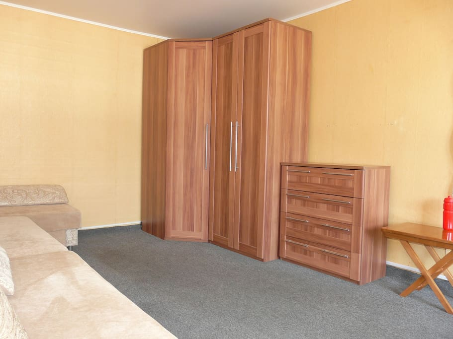 Two spacious wardrobes and a drawer.