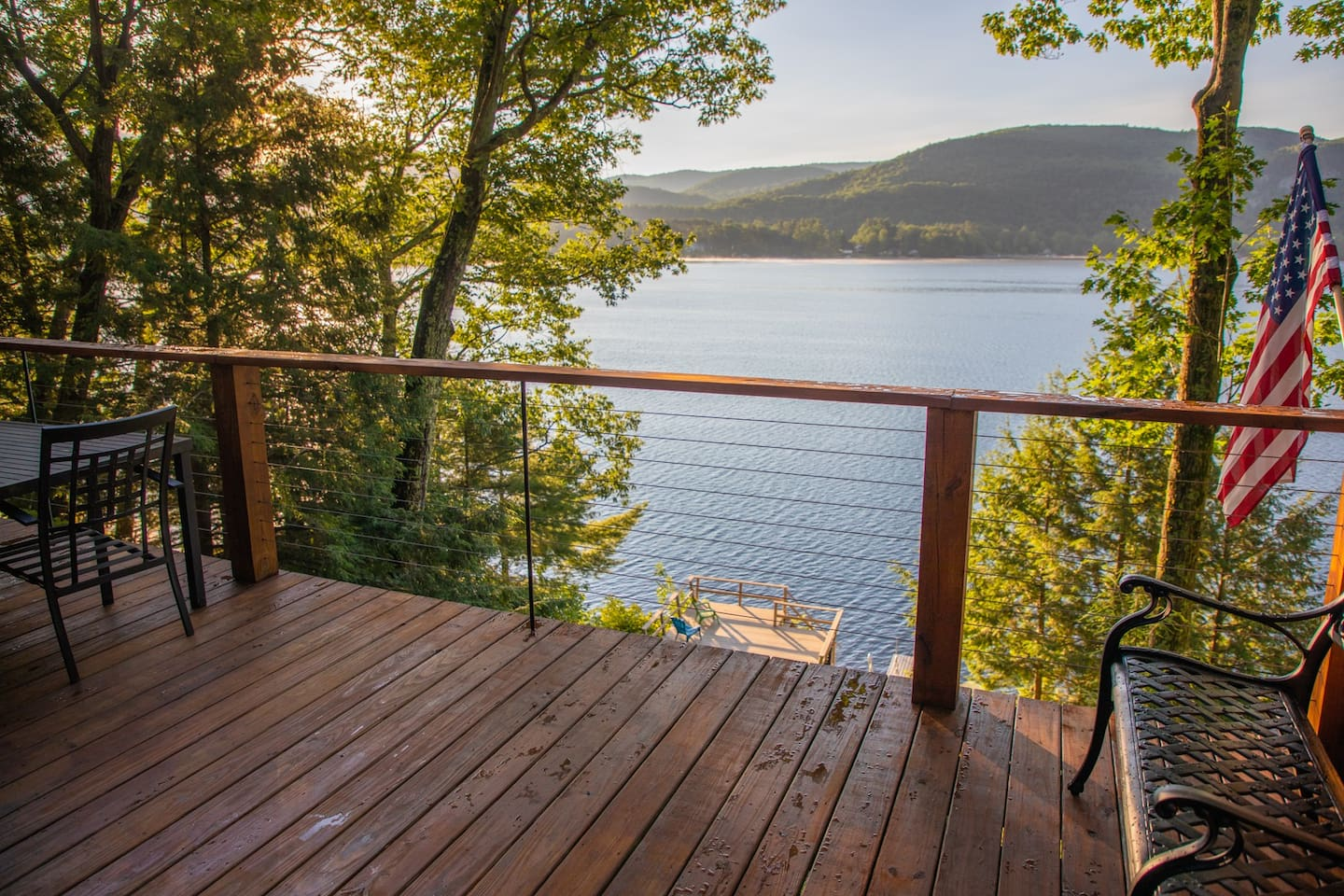 This is your view from the top deck. Lower deck pictured as well. Just steps to your own private dock and beautiful Lake St Catherine!