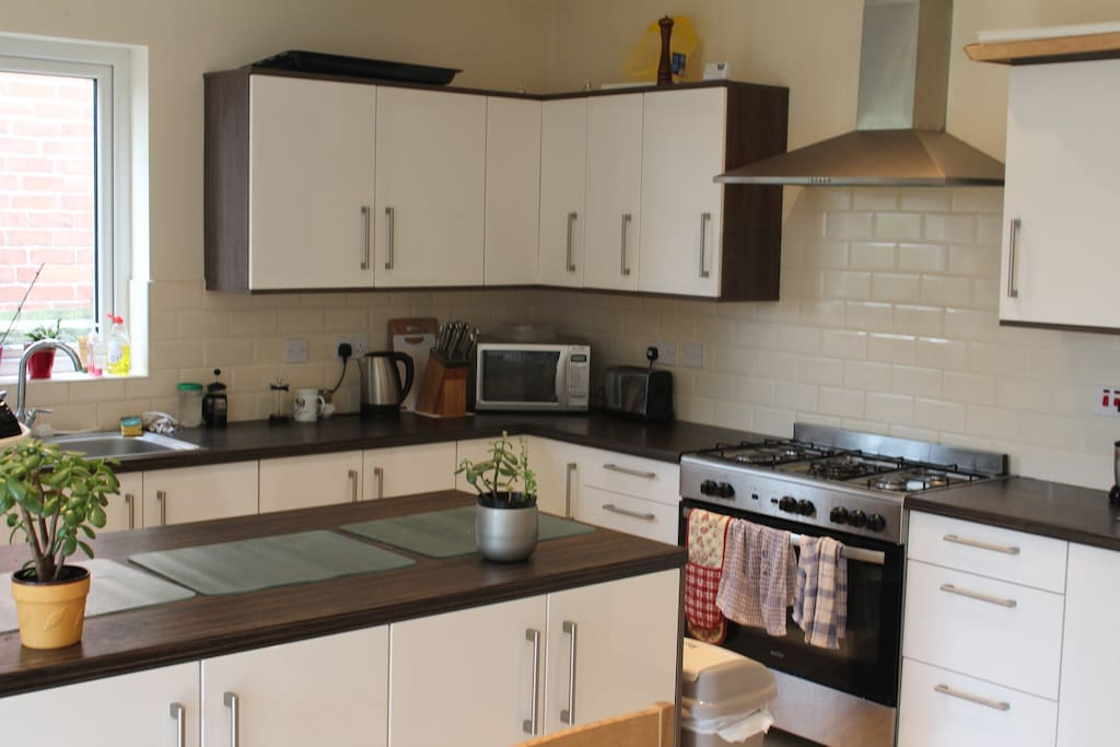 clean, spacious, fully equipped modern kitchen