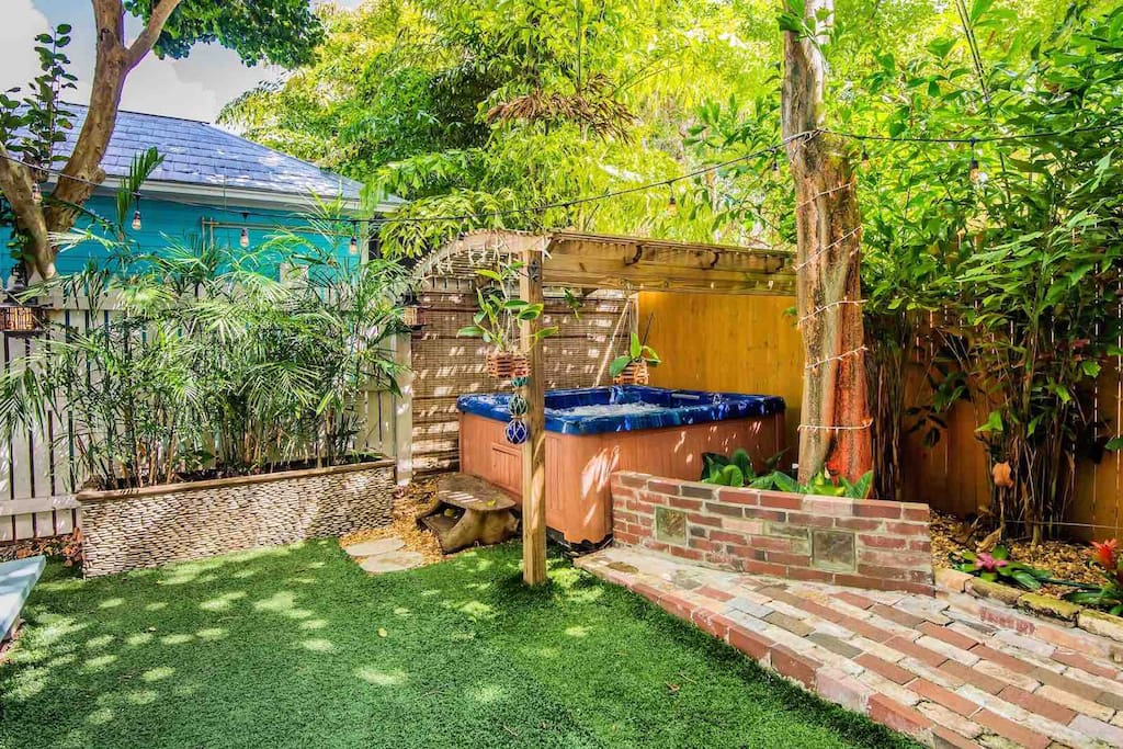 The backyard is completely fenced for privacy and has a turf yard...