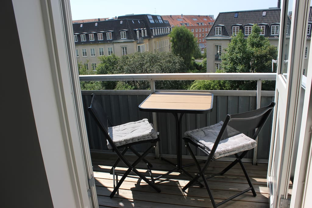 Balcony with sun in the afternoon and in the evening. Is featured with a WEBER gas grill