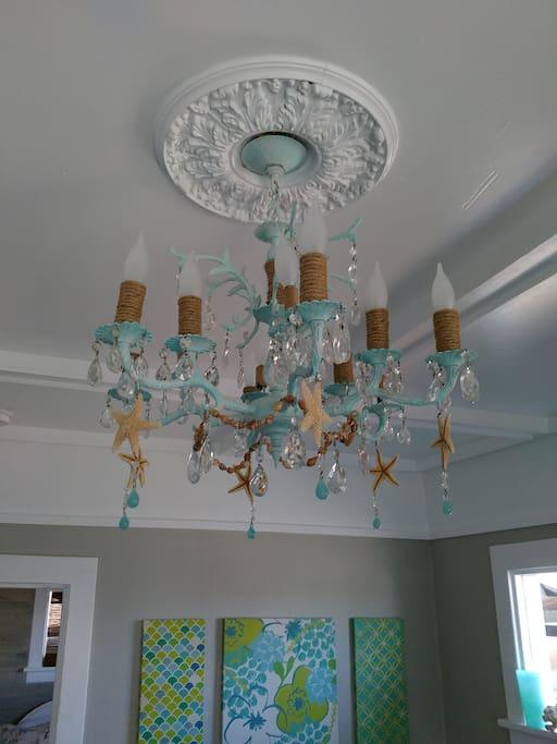 Custom seashell chandelier in living room.