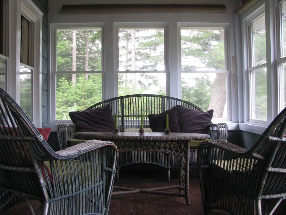 water-front porch; serene spot for morning coffee, a quiet read or games in the evening