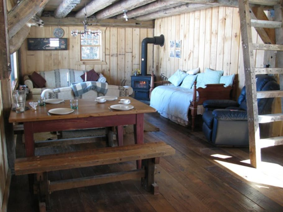Bear Cabin: woodstove, century old flooring, table and benches