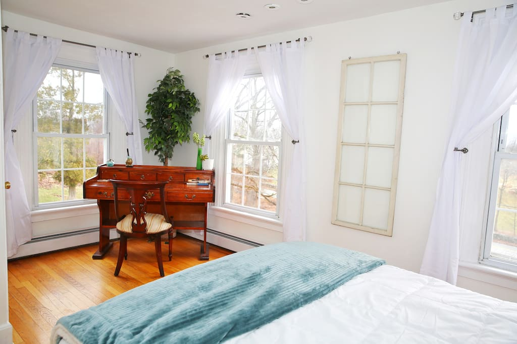 Your bedroom, also known as the poet's retreat Faces Harriman State Park views has a desk and sitting area