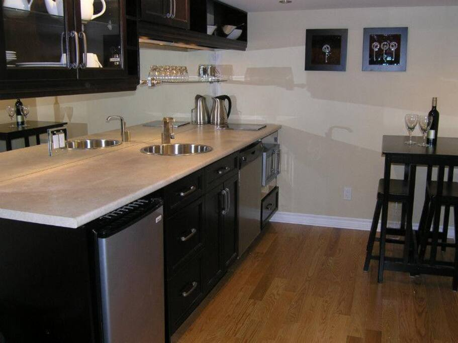 Renovated Kitchen with stainless steel appliances & dining for two.