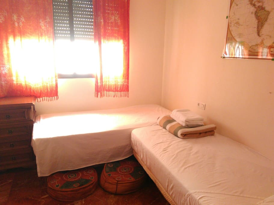 Room with two singles. Not shown is a single mattress which can be used on the floor.