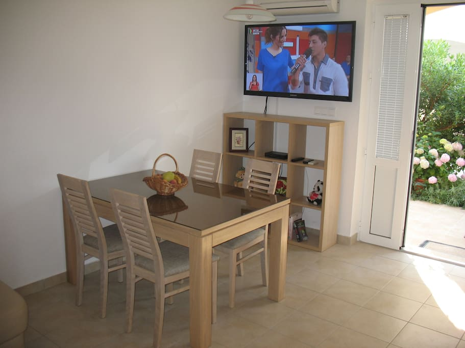 Dining and living area with flat screen sat tv