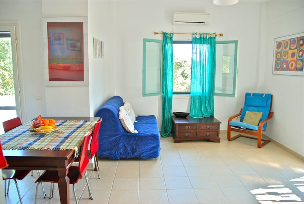 Methoni holiday house.Light and airy living area with air conditioning.
