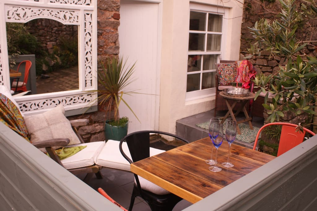 The Studio's walled terrace with sun lounger and dining area
