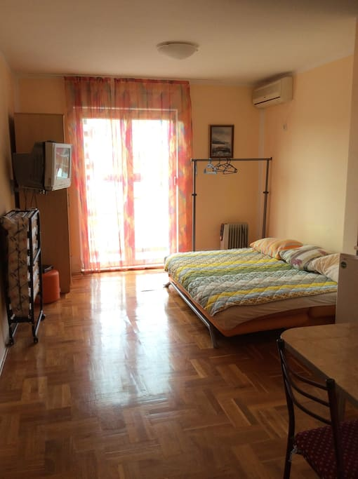1st room with a sofa that sleeps 2 and an additional bed for 1 person if needed