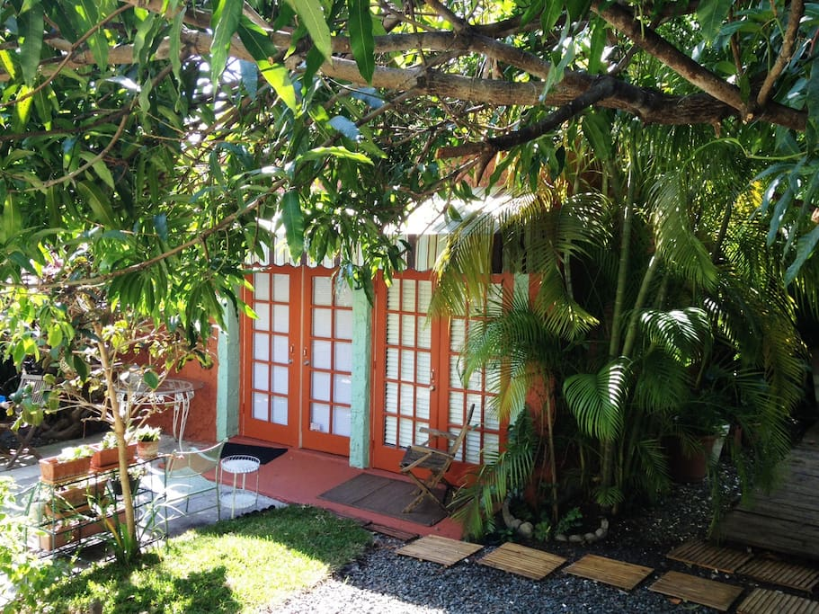 """The gardens are a tropical paradise and have plenty of places to gather and relax"" Garden and cottage"