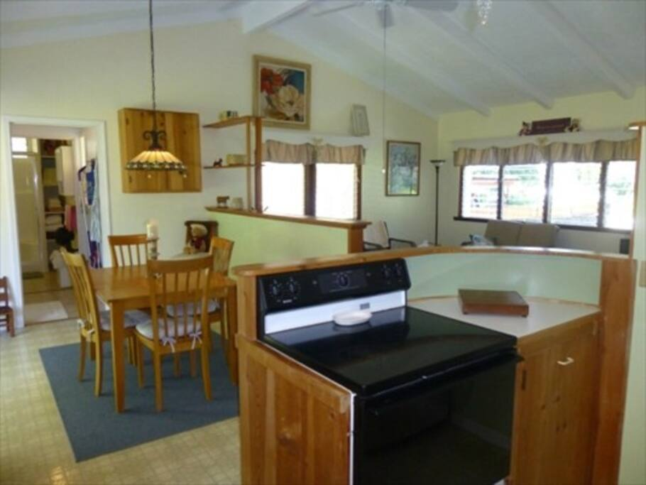 The dining room and a partial view of the laundry room