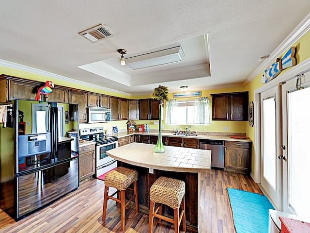 A spacious kitchen features a full suite of appliances and a 2-person island area.