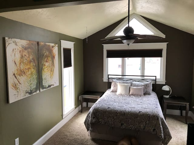 Bedroom 1 with vaulted ceilings and step-down sleeping quarters with queen-sized bed