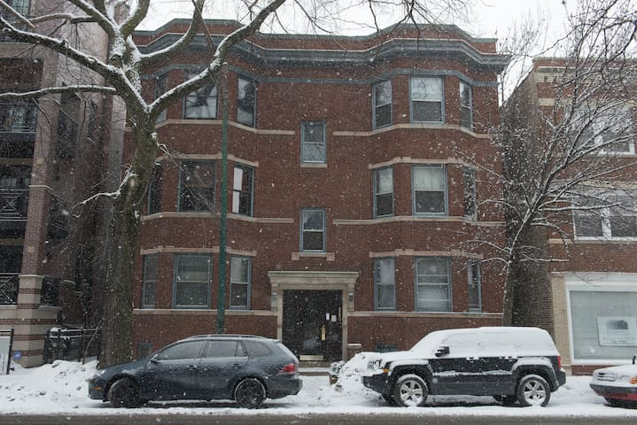 As viewed on a snowy day from Racine Ave.  2nd floor up on the left.  Maybe try to come in the summer ;)