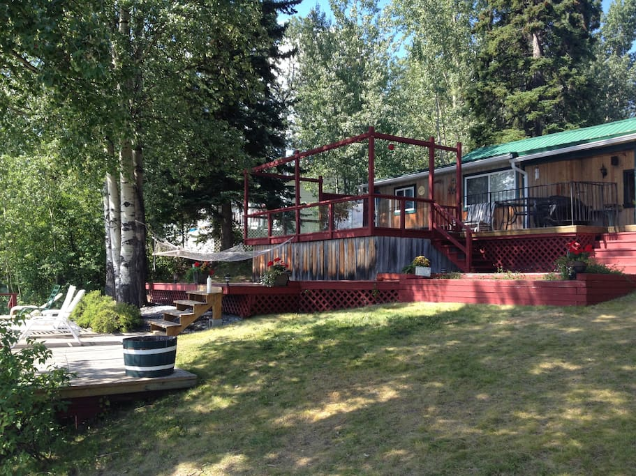 Multiple decks with ample seating and two hammocks.