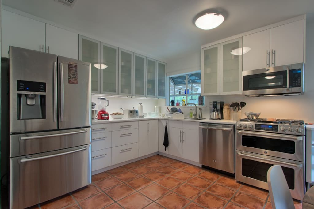 Brand new designer kitchen. Best GE Cafe gas stove with griddle and Speed cook Microwave.