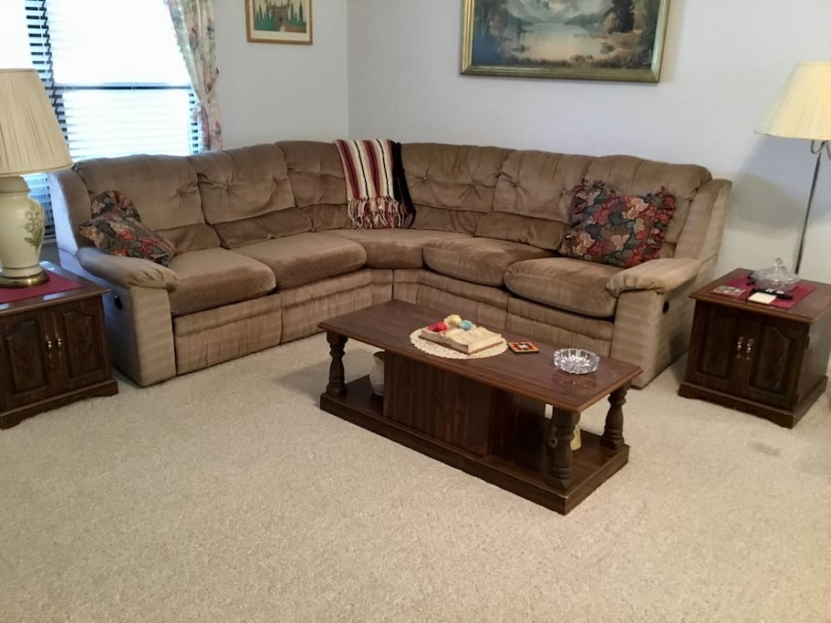 Living Room.  Sofa has recliners on each end.