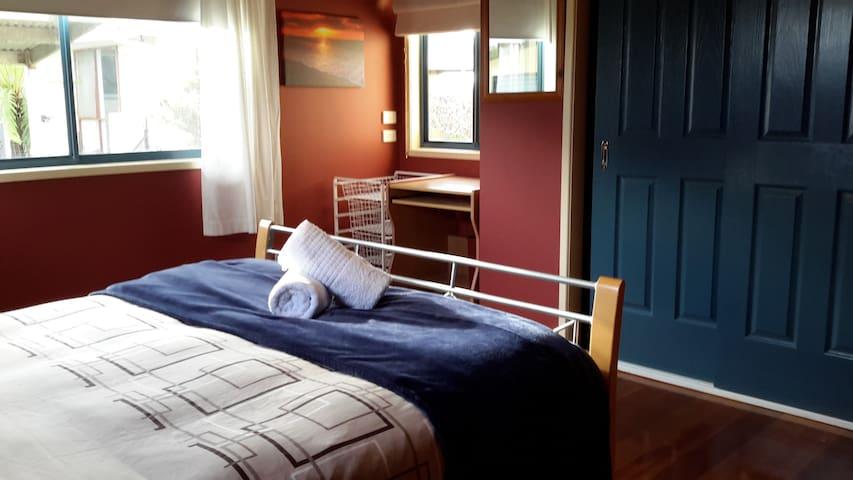 2nd Bedroom, Queen bed in large room on ground floor.