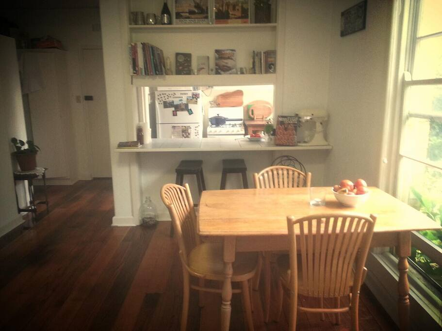 Dining table, including bench space with bar stools