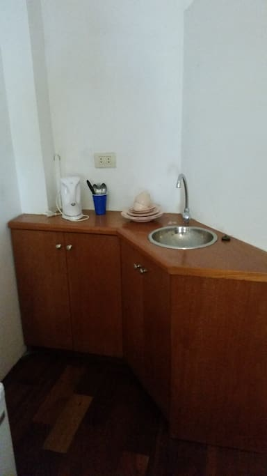 Little space for washing utensiles, includes also a minifridge and a microwave oven!