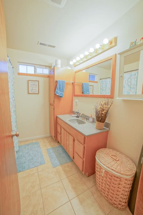 Clean, simple bathroom with tub and shower
