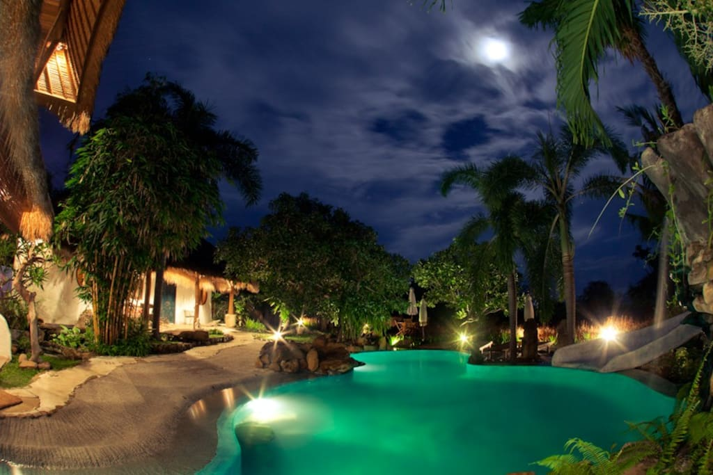 The spectacular pool at night, viewed from the main living area with the Family suite in the distance!